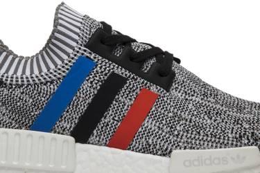 c84076b5b NMD R1 Primeknit  Tri Color . adidas  iconic three stripes logo takes  center stage in the NMD R1   ...